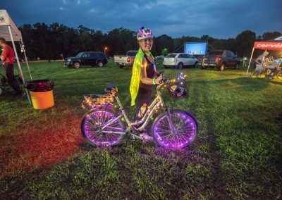 LHT Full Moon Ride female cyclist with decorated bike